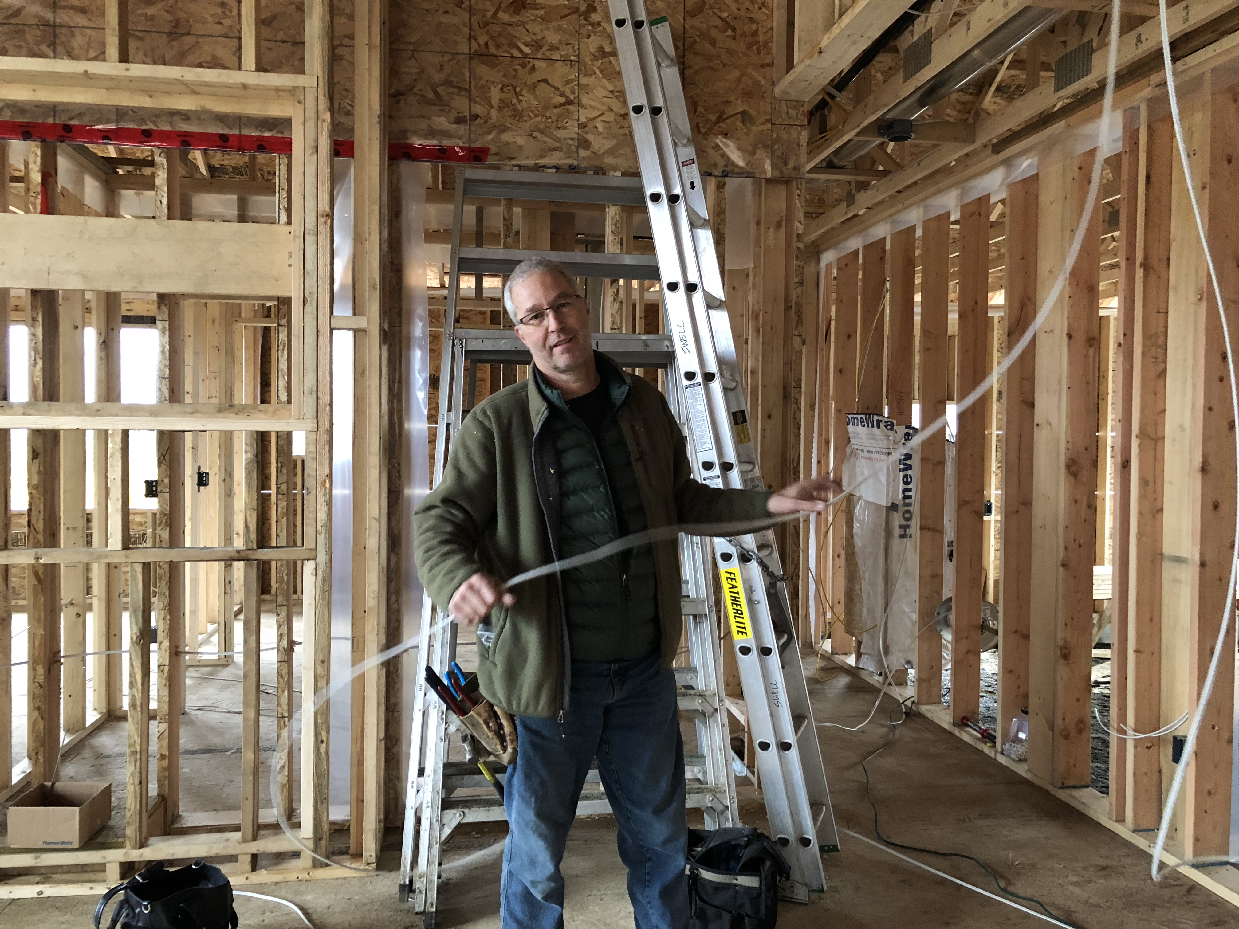 photo of electrician wiring new home in The Ridge