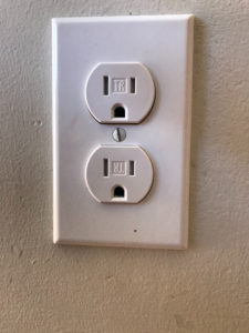 dangerous use of extension cords burned a receptacle - picture of new receptacle